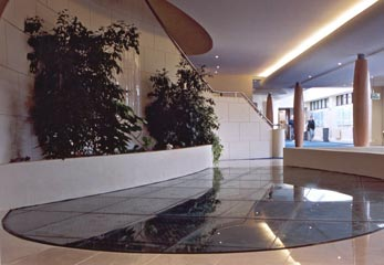 Glass flooring over ornamental fish pond in health Spa