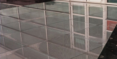 Photo of glass-flooring panels on pedestals in the moat surrounding the Computer Associates Building Slough